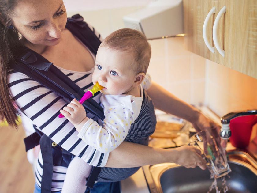 mom babywearing using a baby carrier