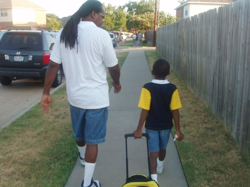 dad walks son to kindergarten