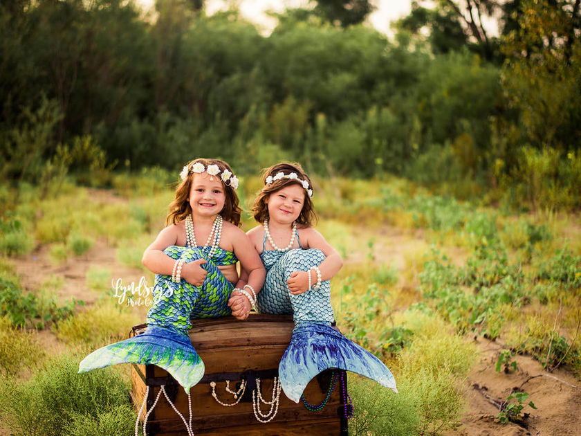 mermaid photo shoot with adorable sisters