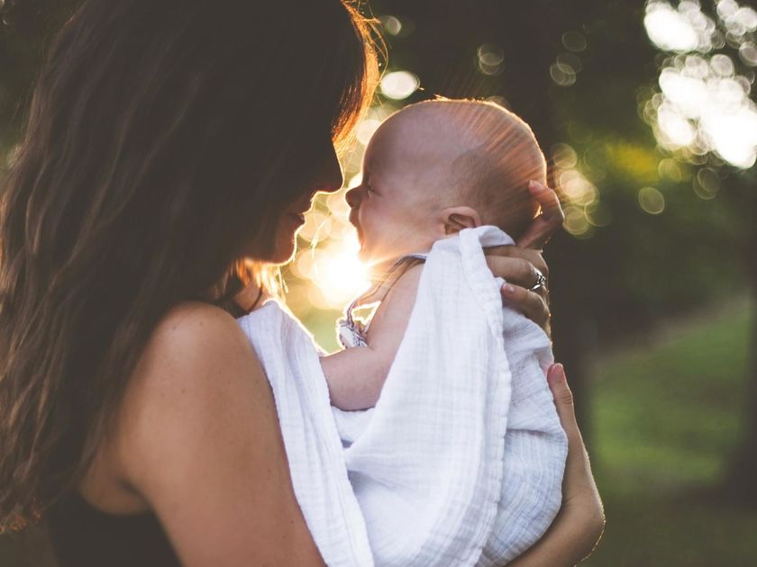Mother and Baby Looking At Each Other Outside Sunset