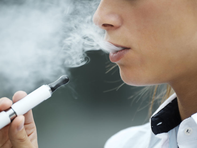Young Person Smoking Electronic Cigarette