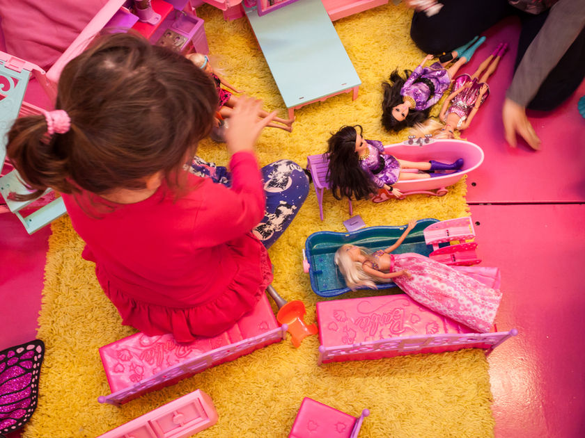 Girl playing with Barbies