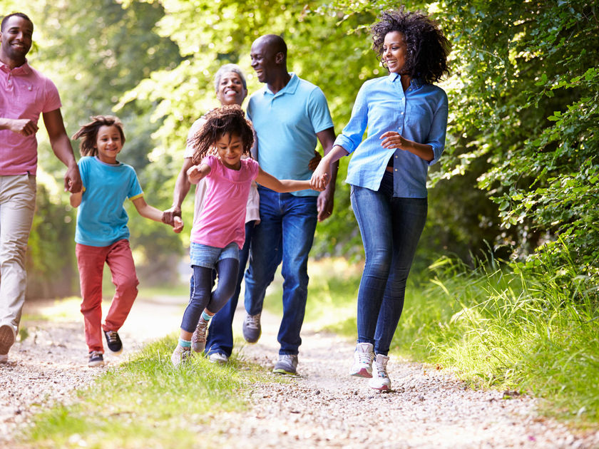 African American Family Walking Outdoors Healthy