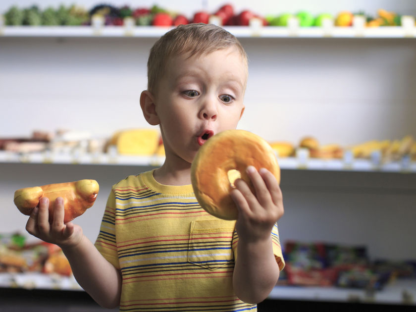 Little Boy Excited Looking At Food