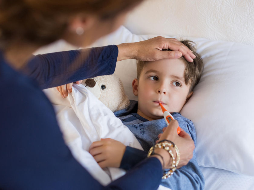 Sick Boy with Mother Checking Temperature