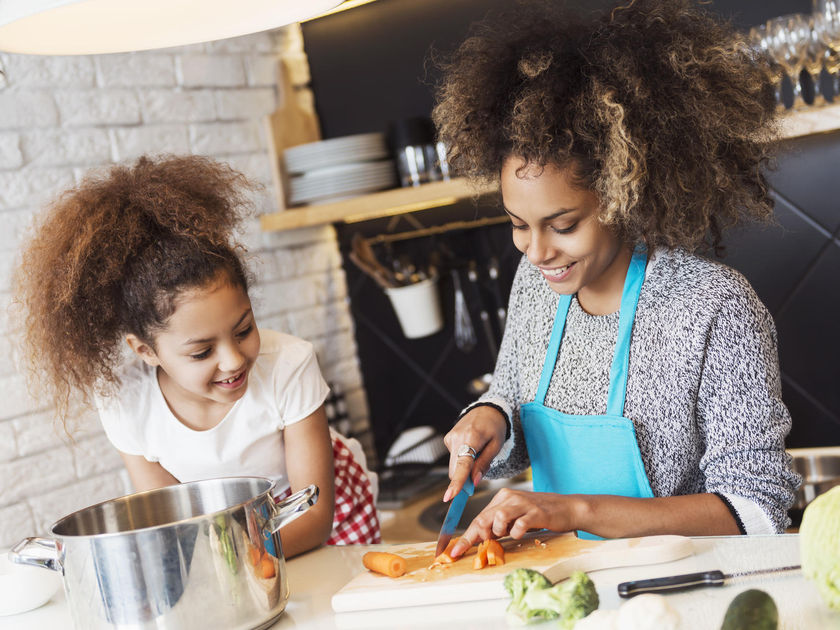 Mother and Daughter Cooking Healthy Dinner