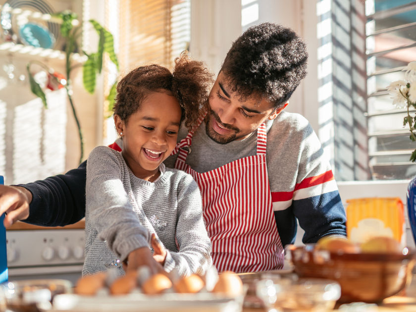 Happy Father and Daughter Baking in Kitchen