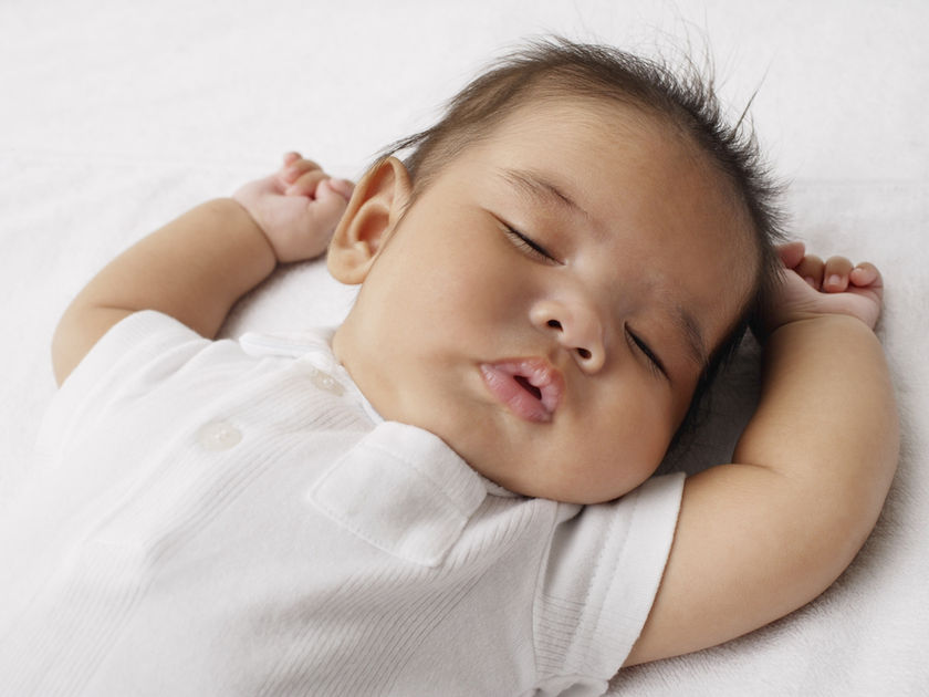 Sleeping baby placed on back