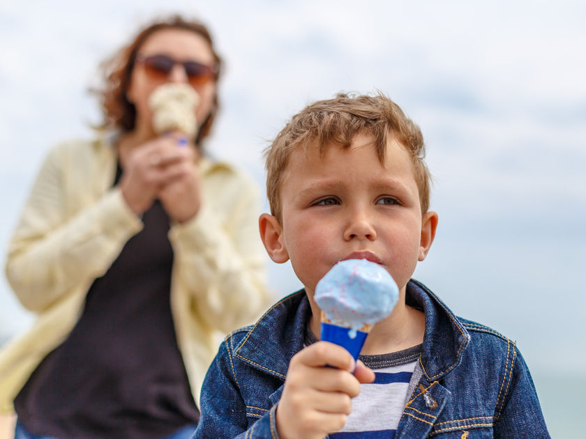 Mom and son eating ice cream on vacation