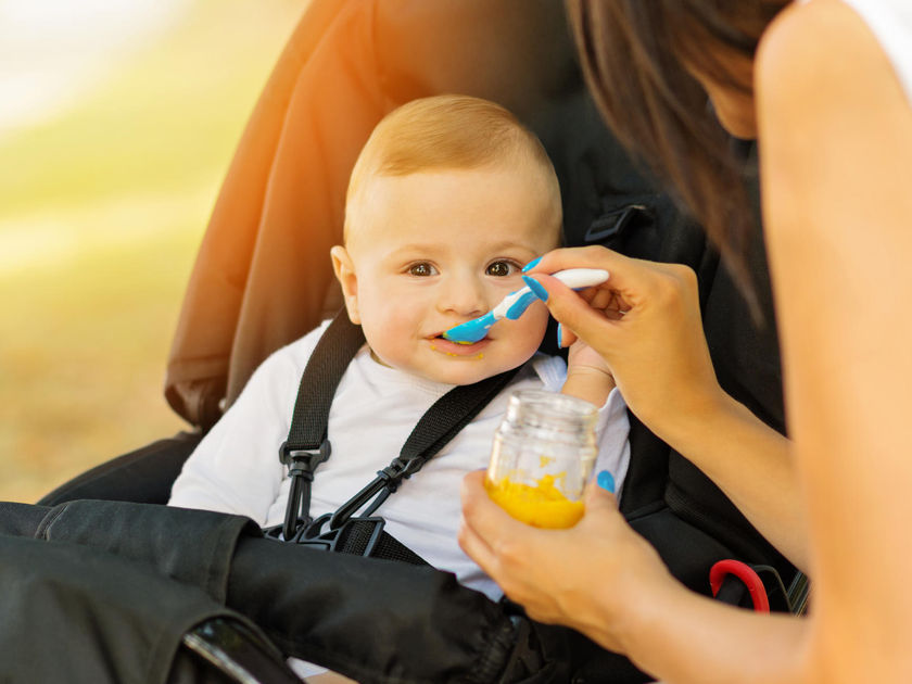 Baby Eating Puree Food Outside Stroller