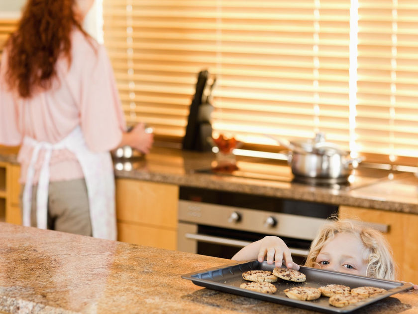 Child Sneaking Cookies From Kitchen Counter