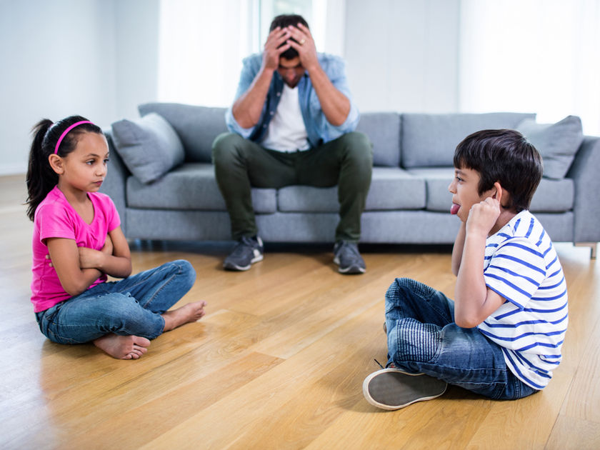 Sibling Squabbles And Annoyed Father On Couch