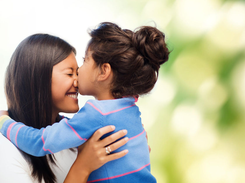 child kissing mother