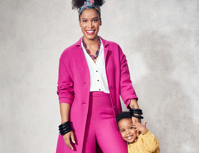mom wearing pink pant suit with child