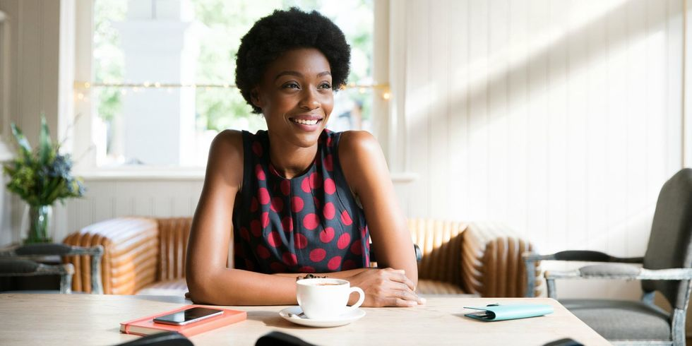 Woman practicing self-care relaxing with coffee