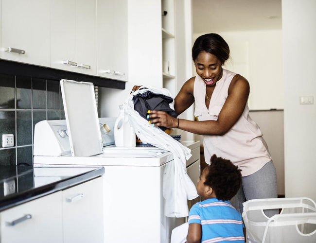 mom doing laundry with son