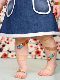 baby with bandaids