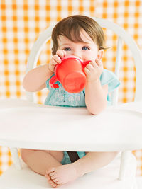 Baby drinking out of sippy cup