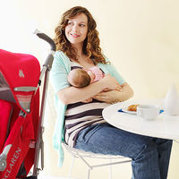 woman in restaurant with baby