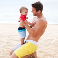 Dad with baby on beach