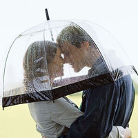 Man and woman under umbrella