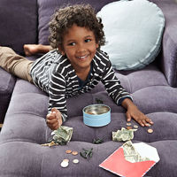 Kid on bed with money