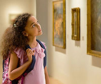 Child looking at artwork in museum