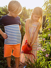 Girl and boy watering plants