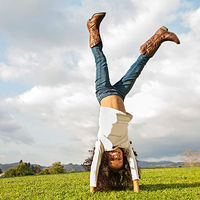 Girl doing cartwheel in a field