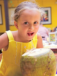 Girl eating from large fruit