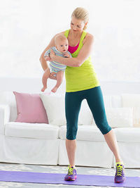 Woman exercising with baby