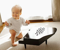 Baby and mini-piano
