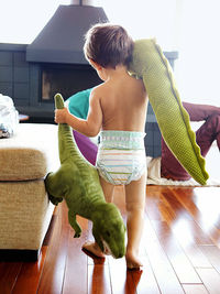 Toddler with stuffed animals
