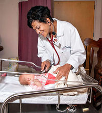 Dr. Marlene Wust-Smith with baby patient
