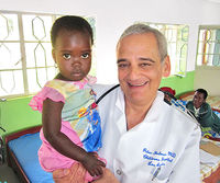 Dr. Peter Shulman with child