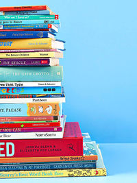 Stack of books on blue background