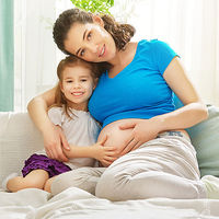 pregnant woman with child