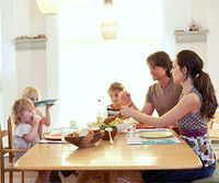 Young family eating dinner together
