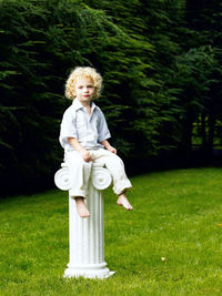 little girl sitting on a pedestal