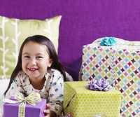 girl with a pile of presents