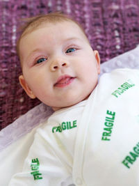 "baby with ""fragile"" onesie"