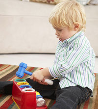 toddler with toy