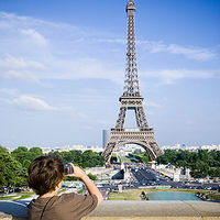 Child taking photo of Eiffel Tower