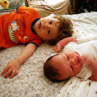 brother with newborn baby