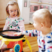 Joanna and Teddy playing the drums