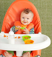 baby in highchair eating