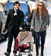 Miranda Kerr and Orlando Bloom with baby
