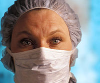 Up close of female nurse of doctor, mask over face