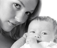 Black and white of mom and newborn baby