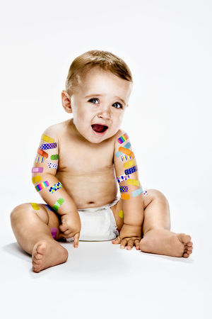 Baby with Colorful Bandaids